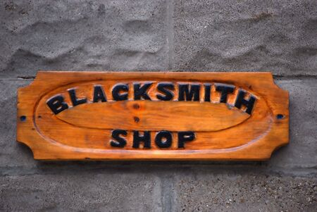 blacksmith shop: Blacksmith Shop Sign Stock Photo