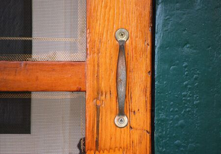 screen: Close-up of an old,wooden screen door Stock Photo