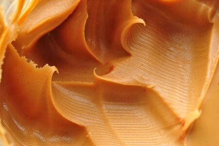 Closeup Image of an Open Jar of Peanut Butter