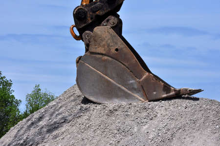 Excavator Shovel and Road Gravel photo