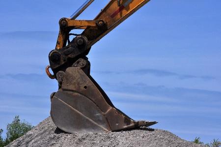 Excavator Shovel and Road Gravel