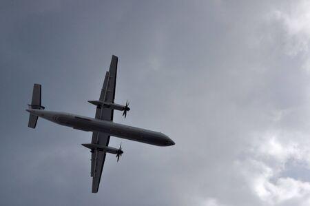 Commercial Airplane Flies Through Cloud Filled Skies