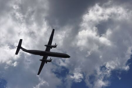 Commercial Airplane Flies Through Cloud Filled Sky
