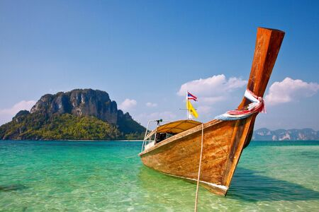 luxery: Boat and rock near tropical island Stock Photo