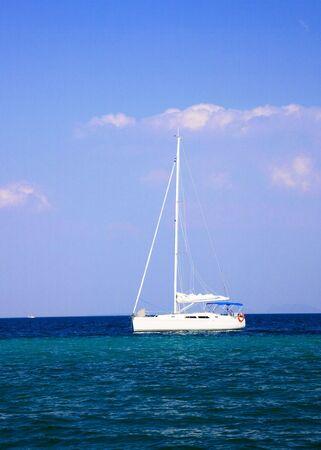 cloud drift: White yacht in sea Stock Photo