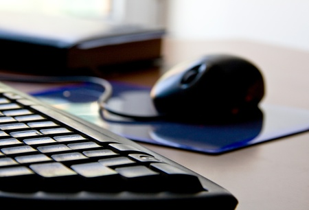 keyboard, mouse and datebook on table photo