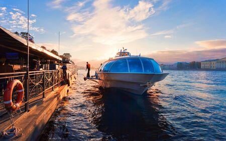 pleasure: Pier on Neva river with a pleasure boat