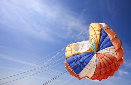 major ocean: The dome of a parachute in the sky with open space Stock Photo