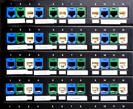 Ports of patch panel on rack in the server, close up Stock Photo