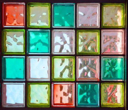 spot the difference: Twenty colored square glass in rectangle as background Stock Photo