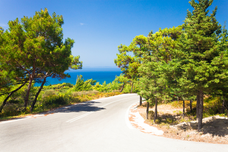 The asphalt road among the mountains, Greece Stock Photo