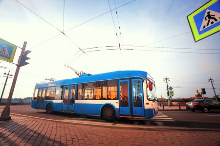 The trolley bus on the road  in St. Petersburg, Russia