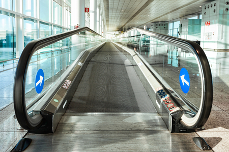 The entrance to the escalator at the airport, day Reklamní fotografie