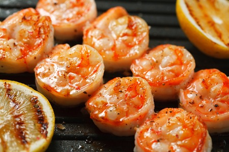 extreme close up: Grilled tiger shrimps with spiced and lemon on the grill