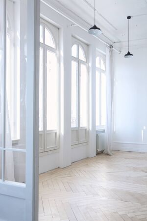 white loft room with large Windows and white curtains Stock Photo