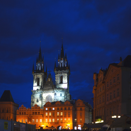 Two Gothic towers of the Church of our lady in the illumination late at night. Mystical view.
