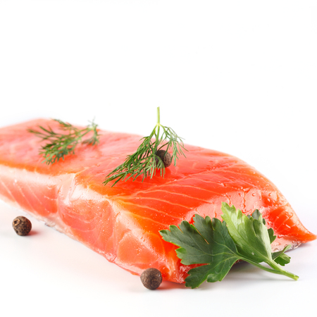 salmon with herbs and spices on white background 版權商用圖片