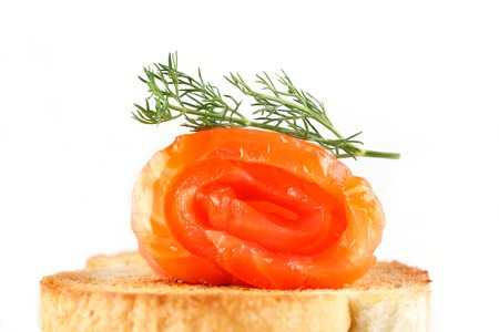 canapes with salmon on toast with greens