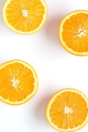 slices of fresh orange on white background Imagens