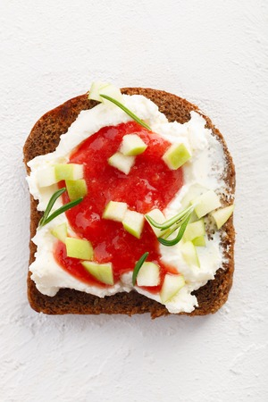 healthy breakfast. Bruschetta with cheese, strawberry jam and apples on white background