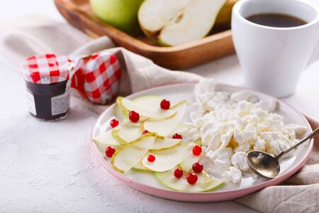 healthy Breakfast with coffee. cottage cheese with slices of pear, Apple and cranberries