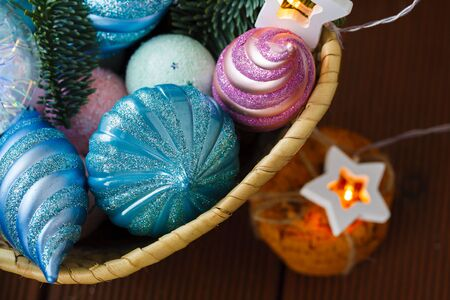 Wicker basket with Christmas vintage toys and garland for Christmas tree Reklamní fotografie