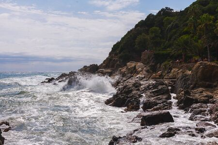 view of the rocky coast of the Mediterranean sea. Spain. Closeup