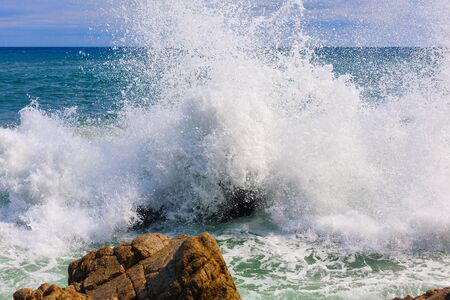 View of the foam from the waves. The wave breaks on the rocks. Nature, seascape. Spain. close up.