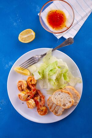 Grilled tiger shrimps in spices, sweet and sour sauce
