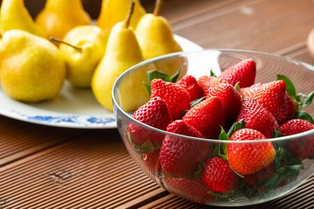 fresh ripe strawberries and pears close up