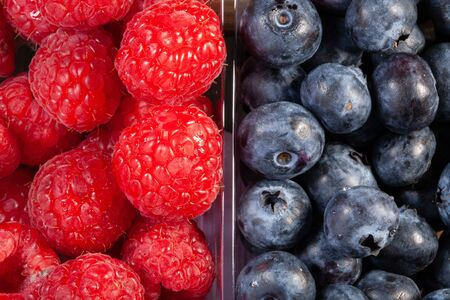 fresh raspberries and blueberries. Close-up view from above Reklamní fotografie