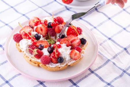 dessert with fresh berries on a white background. Sweet roll Reklamní fotografie - 151979380
