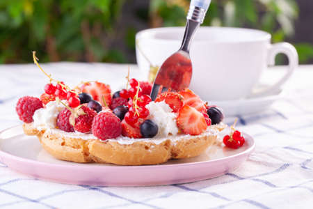 dessert with fresh berries on a white background. Sweet roll