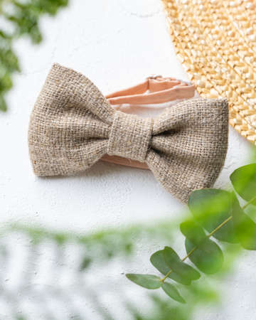bow tie made of natural material on a light background Reklamní fotografie