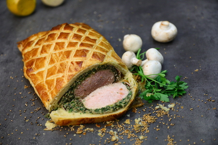 Fillet steak coated with pâté (often pâté de foie gras) and duxelles, which is then wrapped in puff pastry and baked