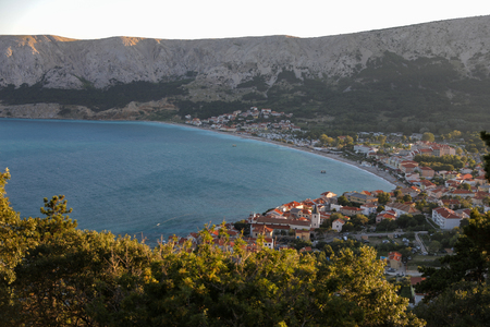 A view to the city on a shore of Adriatic sea from the rocky hill in Croatia, different color tones