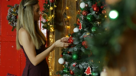 young girl decorate Christmas tree