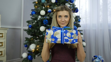 beautiful girl with Christmas gifts 스톡 콘텐츠