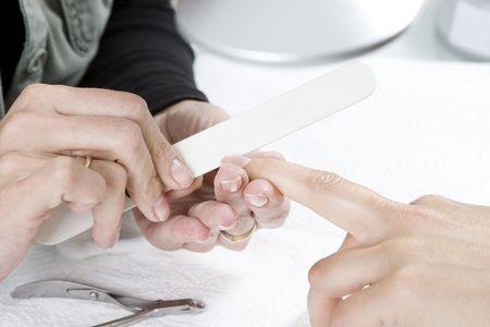 manicurist: Manicurist filing nails