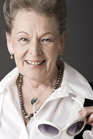 aging face: Fashion portrait of a senior lady Stock Photo