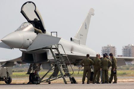 a meeting beside the aircraft