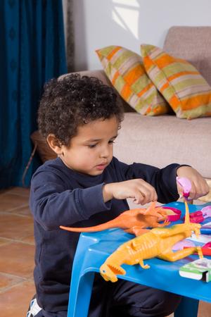 baby cutlery: a cute boy playing