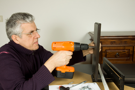 driller: furniture fitter Stock Photo