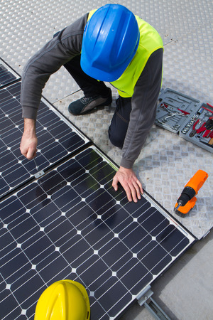 human energy: photovoltaic Stock Photo