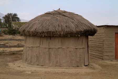 african warriors: masai huts in tanzania Stock Photo