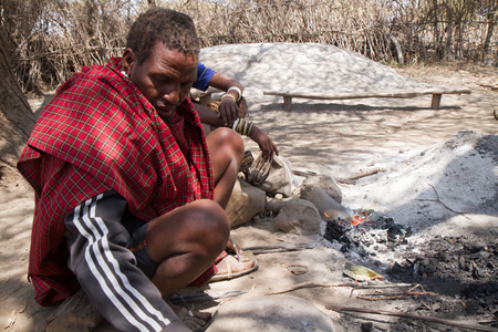hunter gatherer: datoga tribe forgering iron with fire, tanzania