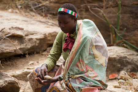 hadzabe woman sitting on her own