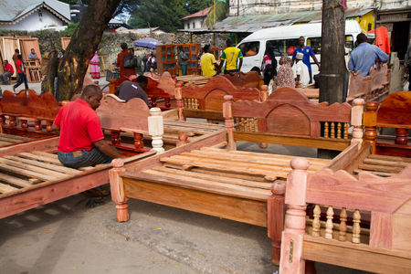 market place: market place, people selling bed frames zanzibar
