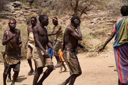 hunter gatherer: hadzabe people dancing in their village