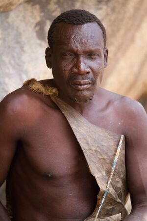 hunter gatherer: hadzabe tribe elderly man portrait Editorial